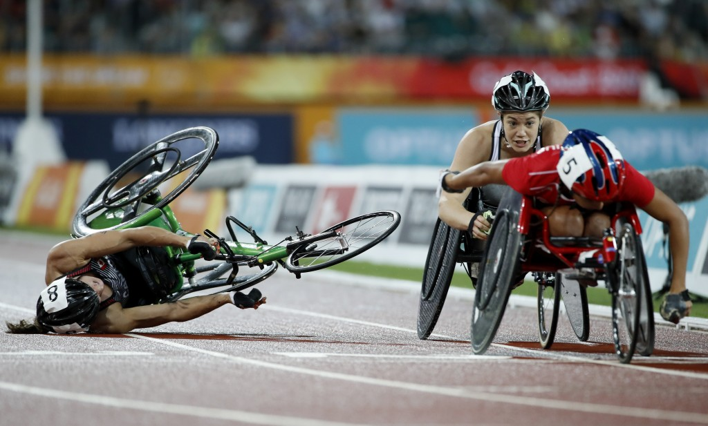 Canada's Jessica Frotten crashes during the women's T54 1500m final at Carrara Stadium during the 2018 Commonwealth Games on the Gold Coast, Australia...