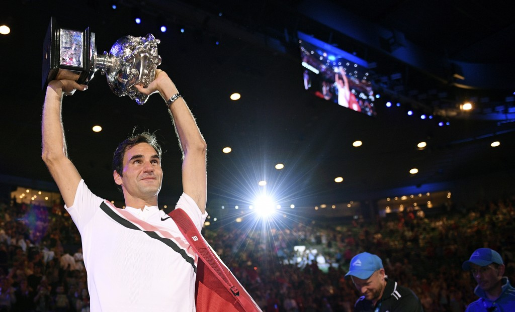 Switzerland's Roger Federer holds his trophy aloft after defeating Croatia's Marin Cilic during the men's singles final at the Australian Open tennis