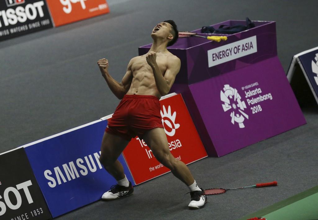 Jonatan Christie of Indonesia celebrates after defeating Kenta Nishimoto of Japan during their men's single semifinals badminton match at the 18th Asi...