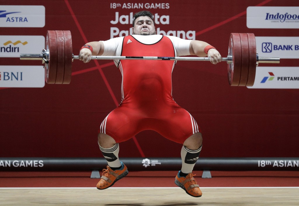 Pakistan's Muhammad Nooh Butt compete at the men's +105kg weightlifting at the 18th Asian Games in Jakarta, Indonesia, Monday, Aug. 27, 2018. (AP Phot...