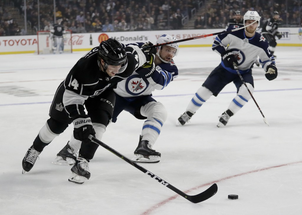 Los Angeles Kings left wing Brendan Leipsic vies for the puck against Winnipeg Jets defenseman Josh Morrissey during the second period of an NHL hocke