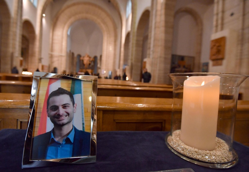 A portrait of Antonio Megalizzi, the Italian reporter killed during a terrorist attack in Strasbourg, is placed next to a candle at the church 'Cristo...