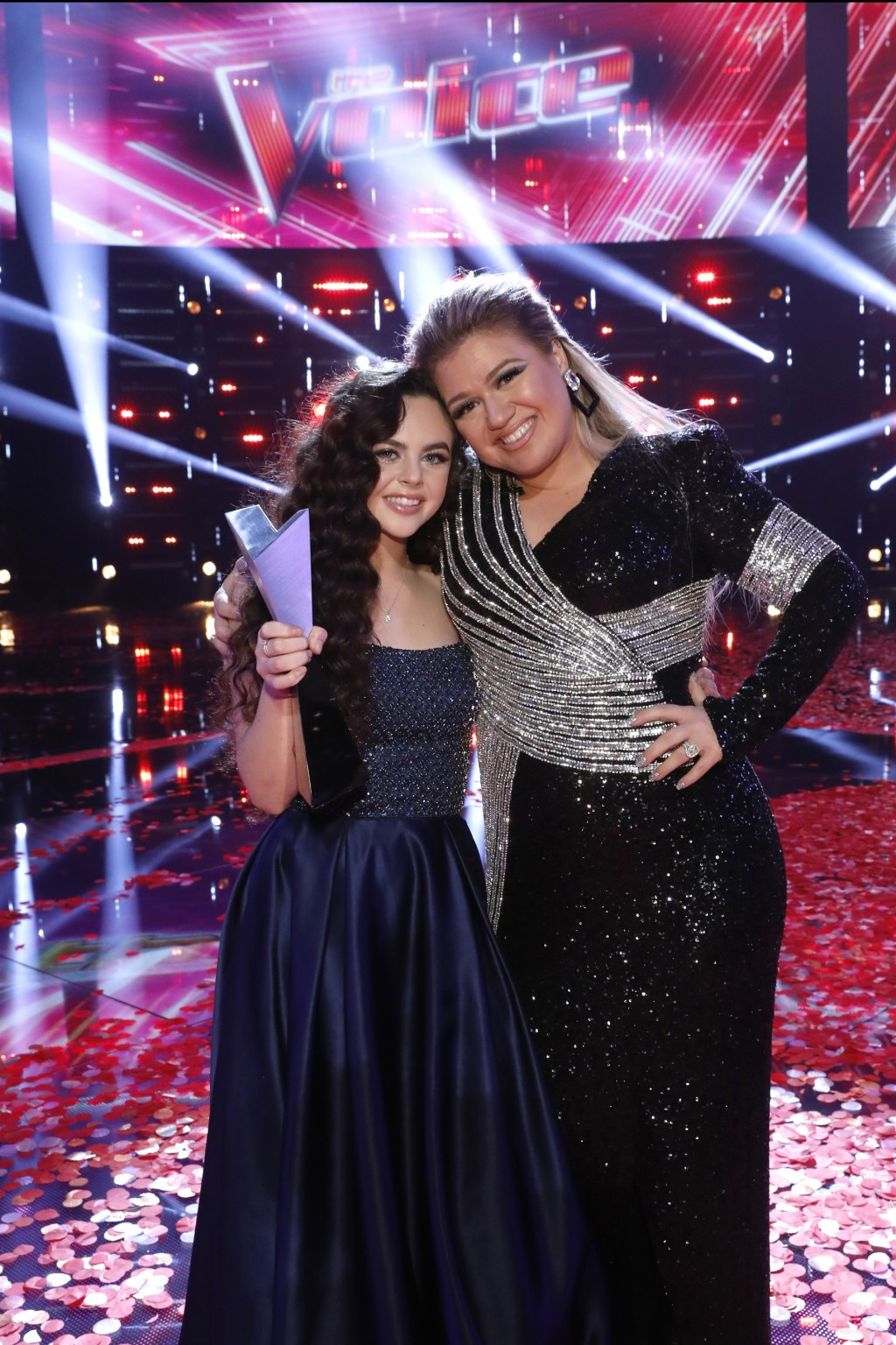 """This photo provided by NBC shows """"The Voice"""" finalist, Chevel Shepherd, left, for season 15, and singer Kelly Clarkson Tuesday, Dec. 18, 2018, in Univ..."""