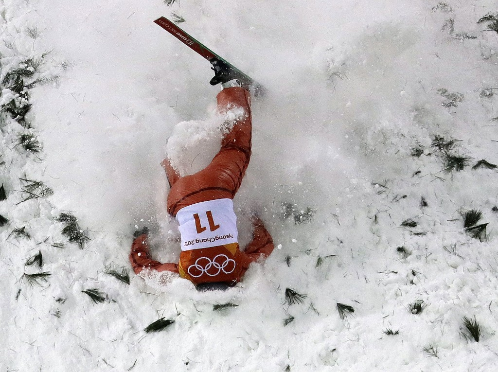AllaTsuper, of Belarus, crashes during the women's freestyle aerial final at Phoenix Snow Park at the 2018 Winter Olympics in Pyeongchang, South Kore...