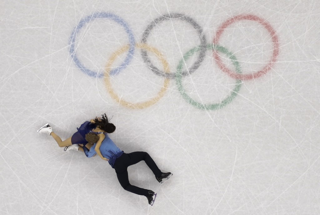 Madison Chock and Evan Bates of the United States fall during the ice dance, free dance figure skating final in the Gangneung Ice Arena at the 2018 Wi...