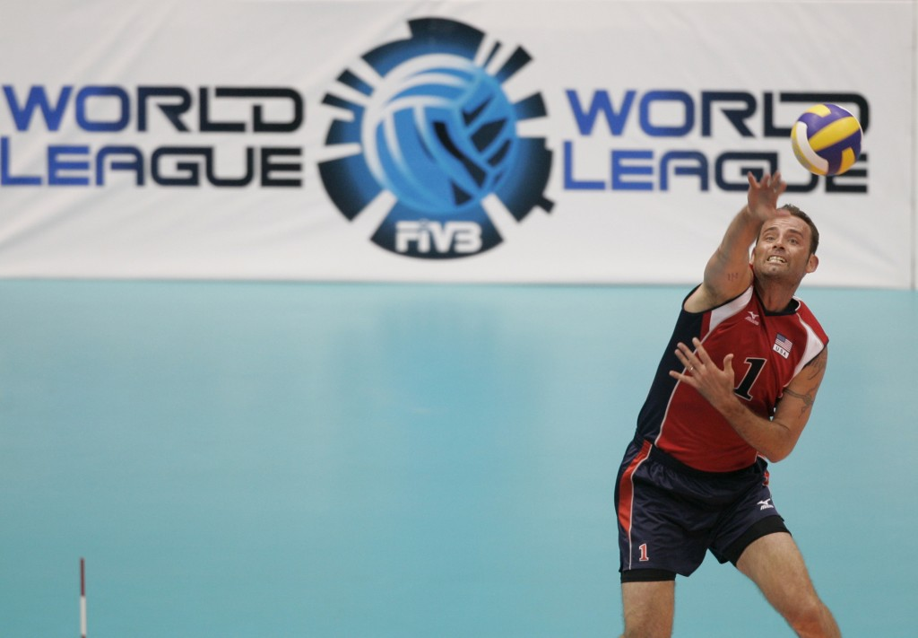 FILE - In this July 23, 2008 file photo, U.S. Lloy Ball serves during a World League volleyball match against Serbia in Rio de Janeiro. Four-time Olym