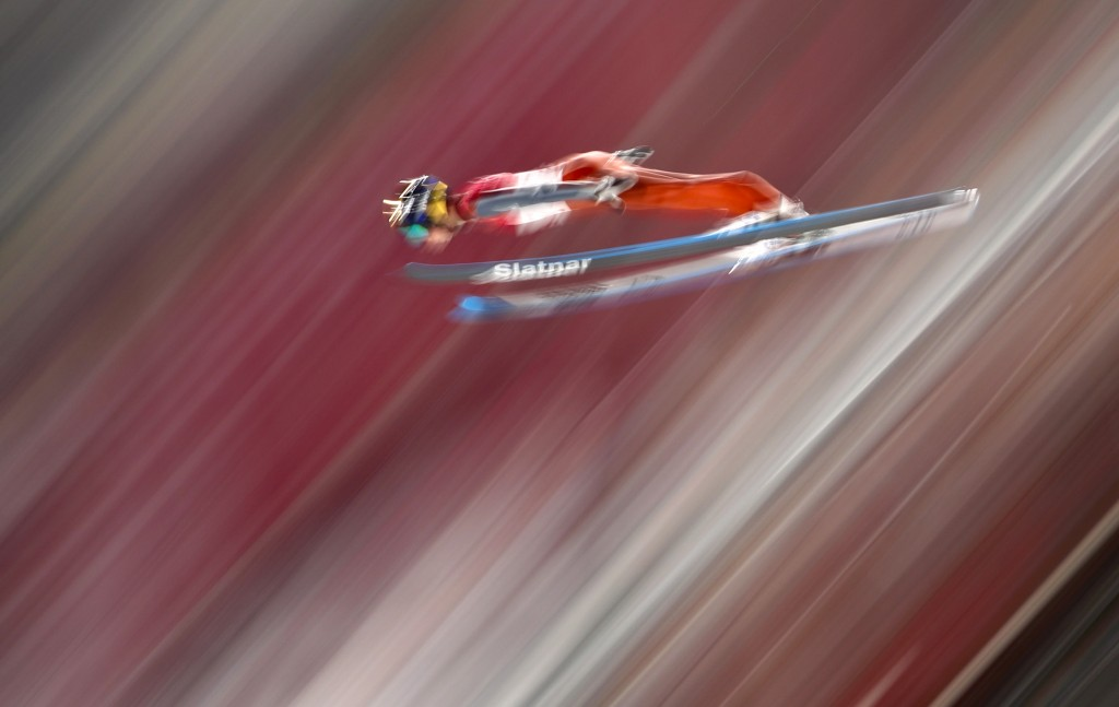 Tilen Bartol, of Slovenia, soars through the air during qualification for the men's large hill individual ski jumping competition at the 2018 Winter O
