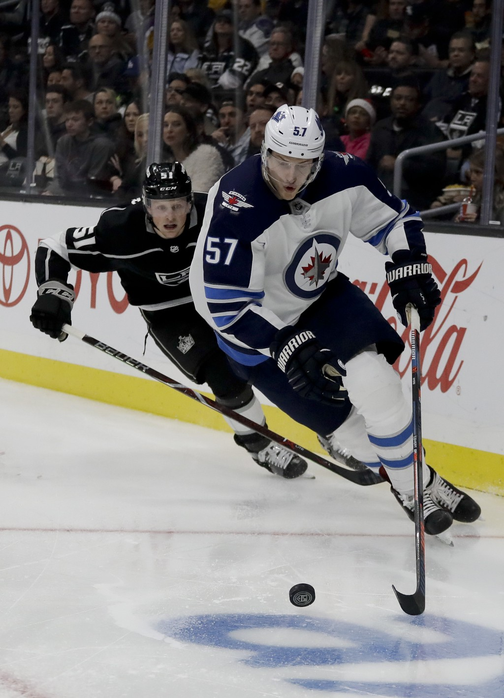 Winnipeg Jets defenseman Tyler Myers, right, vies for the puck against Los Angeles Kings left wing Austin Wagner during the second period of an NHL ho