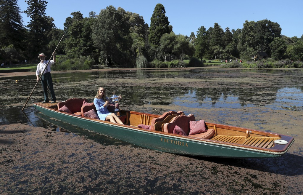 Denmark's Caroline Wozniacki is taken for a ride on a punt with her Australian Open trophy, the Daphne Akhurst Memorial Cup in the Royal Botanical Gar...