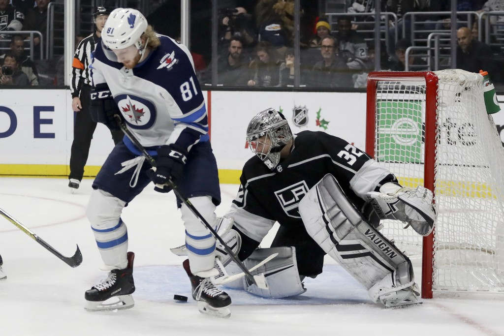 Los Angeles Kings goaltender Jonathan Quick blocks a shot between the legs of Winnipeg Jets left wing Kyle Connor during the first period of an NHL ho