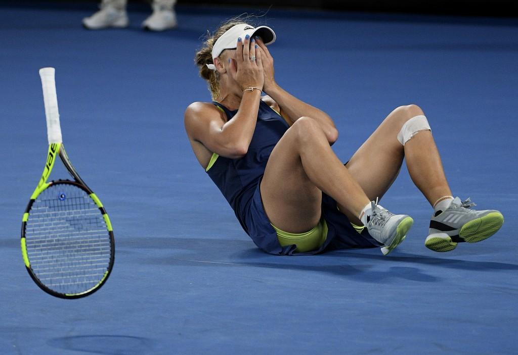 Denmark's Caroline Wozniacki celebrates after defeating Romania's Simona Halep during the women's singles final at the Australian Open tennis champion...