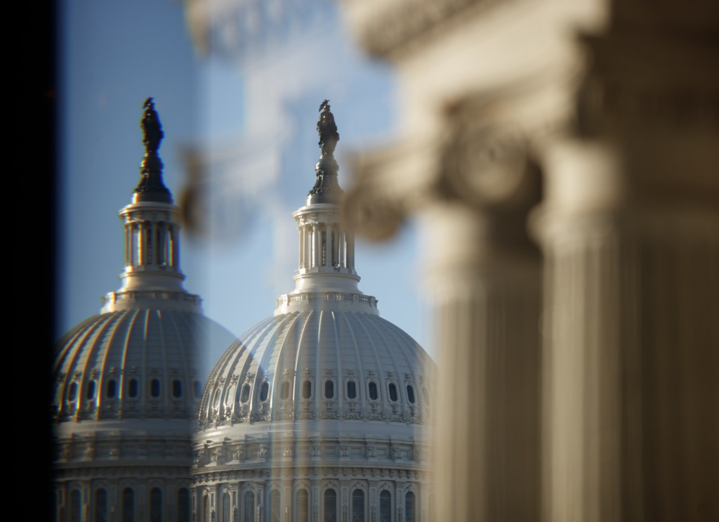 The U.S. Capitol Building Dome is seen through a beveled window at the Library of Congress in Washington, Wednesday, Dec. 19, 2018. President Donald T...