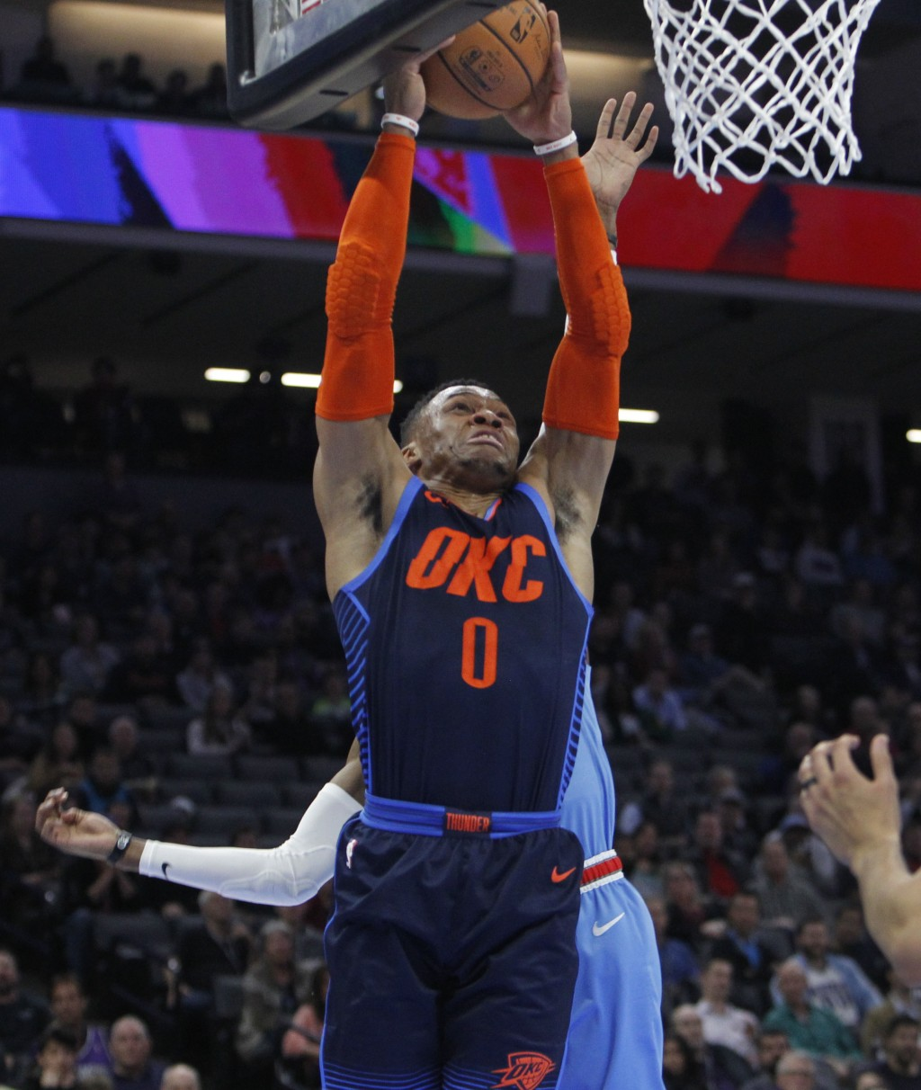 Oklahoma City Thunder guard Russell Westbrook (0) drives to the basket against the Sacramento Kings during the first half of an NBA basketball game in