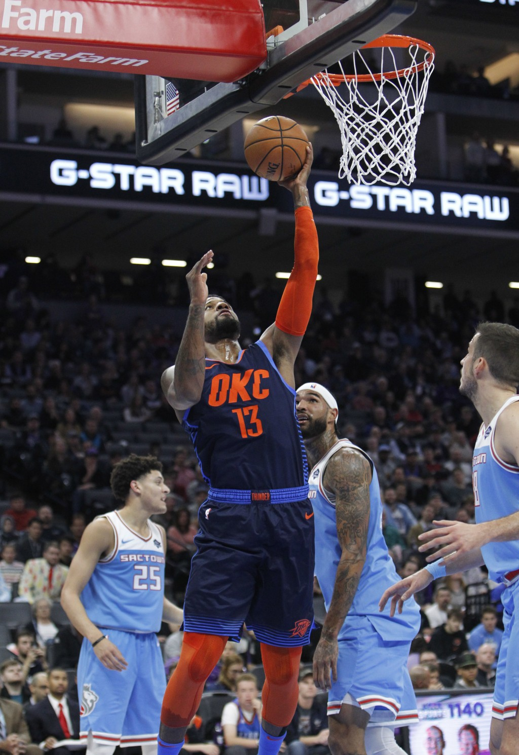 Oklahoma City Thunder forward Paul George (13) breaks away for a basket against the Sacramento Kings during the first half of an NBA basketball game i...