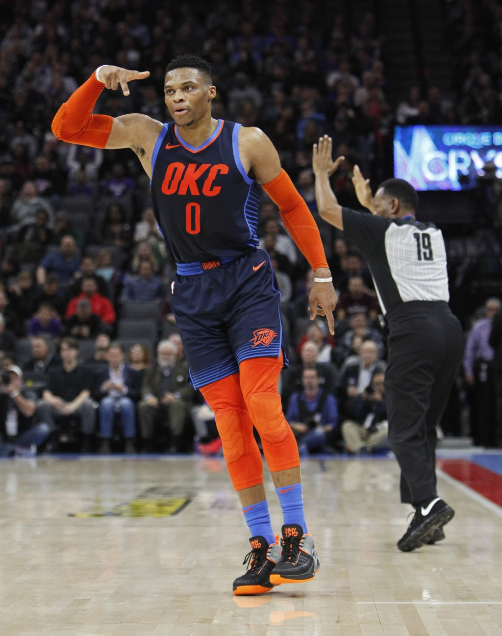 Oklahoma City Thunder guard Russell Westbrook (0) celebrates after hitting a 3-point basket against the Sacramento Kings during the first half of an N...