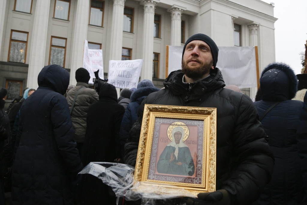 Believers of the Ukrainian Orthodox Church of Moscow Patriarchy protest against the creation of a Ukrainian independent church, in front of the parlia