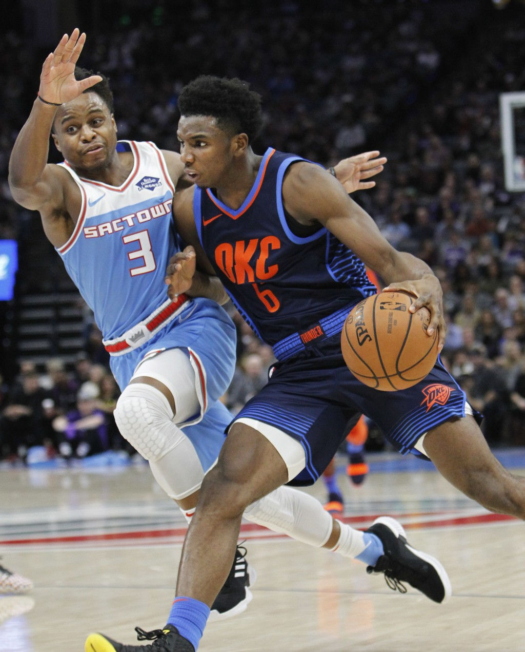 Oklahoma City Thunder guard Hamidou Diallo (6) drives to the basket against Sacramento Kings guard Yogi Ferrell (3) during the first half of an NBA ba