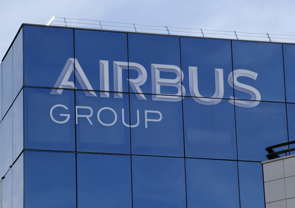 FILE - In this May 6, 2016 file photo, the logo of the Airbus Group is pictured in Suresnes, outside Paris. Shares in Airbus are sinking on a report i
