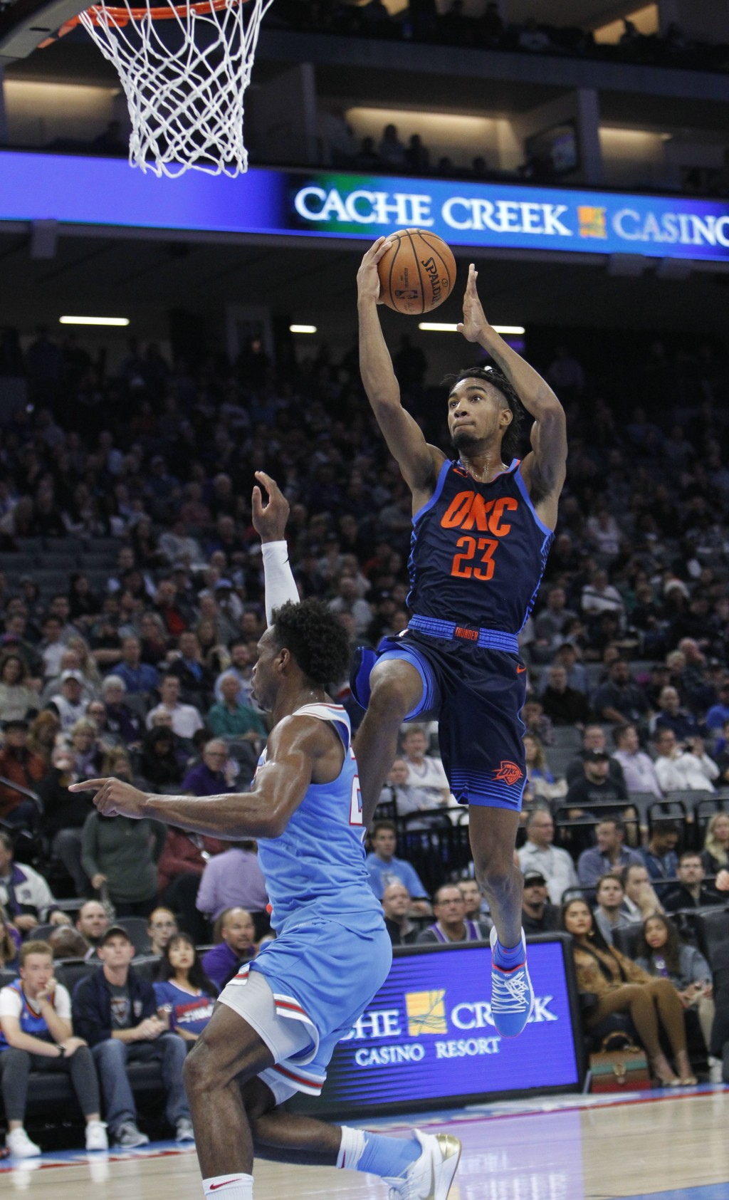 Oklahoma City Thunder guard Terrance Ferguson (23) drives to the basket against Sacramento Kings guard Buddy Hield (24) during the first half of an NB...