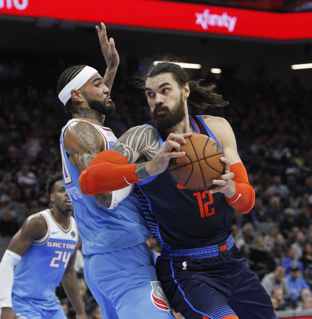 Oklahoma City Thunder center Steven Adams (12) battles for position against Sacramento Kings center Willie Cauley-Stein (00) during the first half of ...