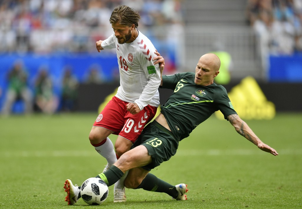 FILE - In this June 21, 2018, file photo, Australia's Aaron Mooy, right, vies for the ball against Denmark's Lasse Schone during the group C match bet...