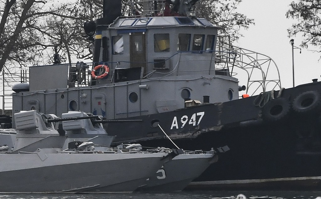 FILE - In this Nov. 25, 2018 file photo, damage can be seen to one of three Ukrainian ships seized by Russia during a naval incident near the annexed