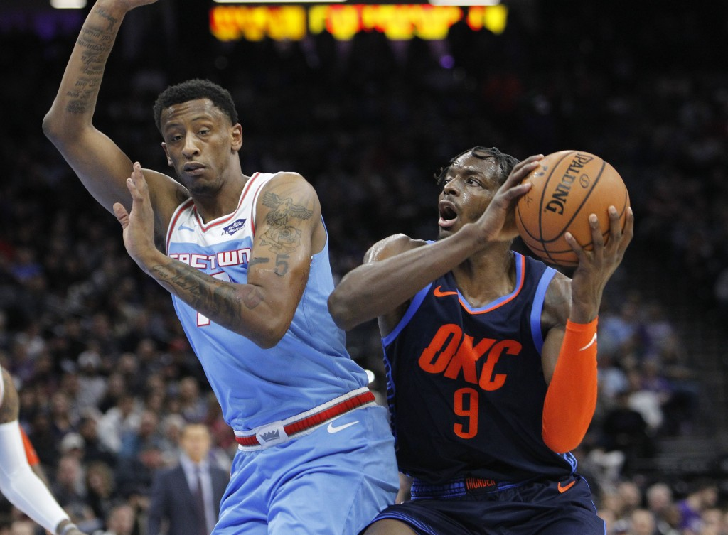 Oklahoma City Thunder forward Jerami Grant (9) battles for position against Sacramento Kings forward Troy Williams (19) during the first half of an NB...
