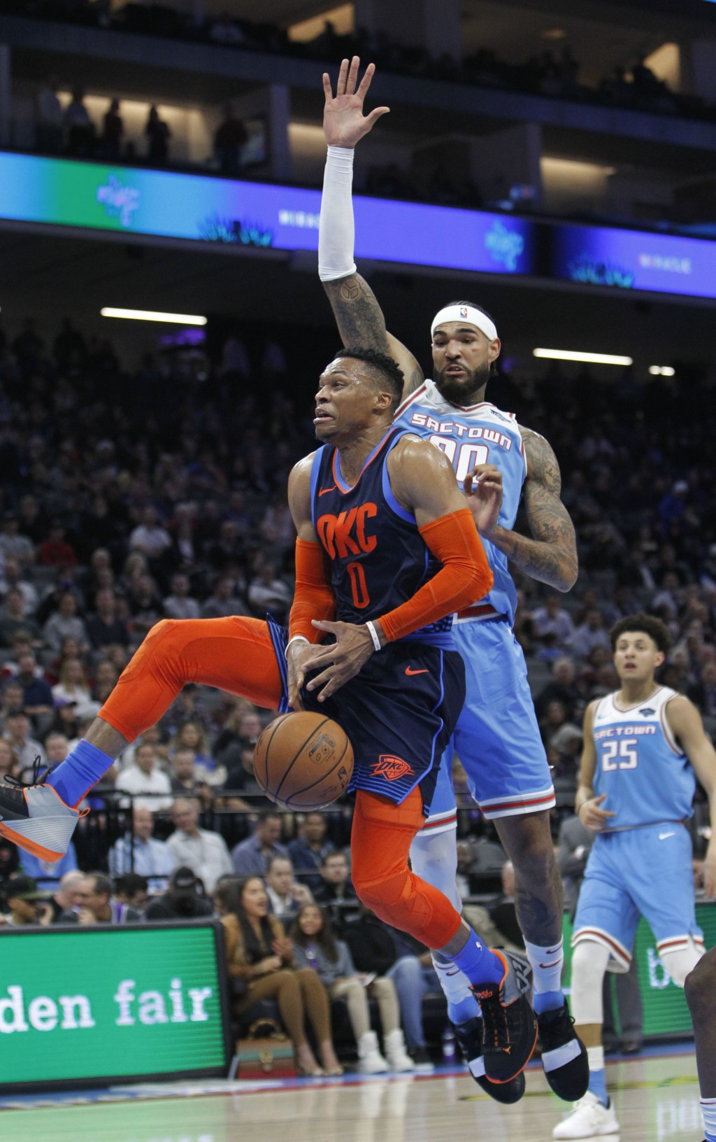 Oklahoma City Thunder guard Russell Westbrook (0) loses the ball while driving to the basket against Sacramento Kings center Willie Cauley-Stein (00) ...