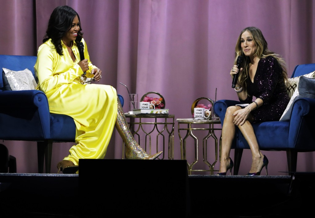 """Former first lady Michelle Obama, left, is interviewed by Sarah Jessica Parker during an appearance for her book, """"Becoming: An Intimate Conversation"""