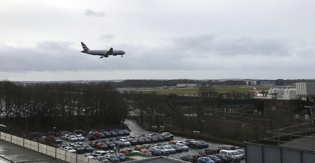A plane comes in to land at Gatwick Airport in England, Friday, Dec. 21, 2018. Flights resumed at London's Gatwick Airport on Friday morning after dro...
