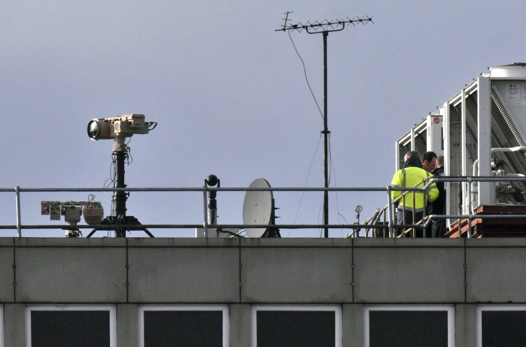 Counter drone equipment is deployed on a rooftop at Gatwick airport in Gatwick, England, Friday, Dec. 21, 2018. Flights resumed at London's Gatwick Ai