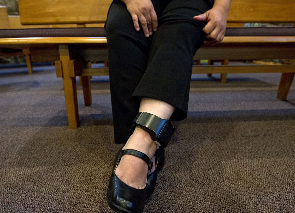 Undocumented Rosa Gutierrez Lopez of El Salvador show her ankle bracelet during an interview with The Associated Press after she sought sanctuary at C...