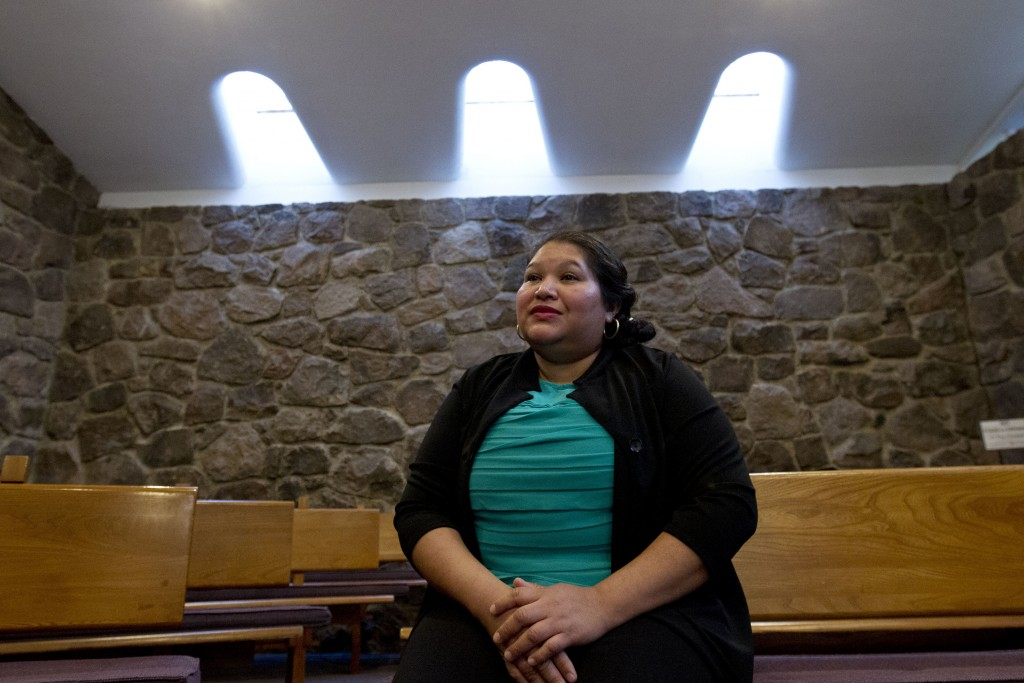 Undocumented Rosa Gutierrez Lopez of El Salvador speaks during an interview with The Associated Press after she sought sanctuary at Cedar Lane Unitari