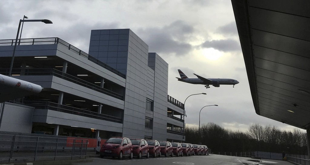 A plane comes in to land at Gatwick Airport in England, Friday, Dec. 21, 2018. Flights resumed at London's Gatwick Airport on Friday morning after dro