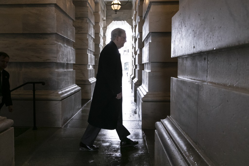 Senate Majority Leader Mitch McConnell, R-Ky., arrives at the Capitol as work continues to meet a Friday night deadline to avoid a partial government ...