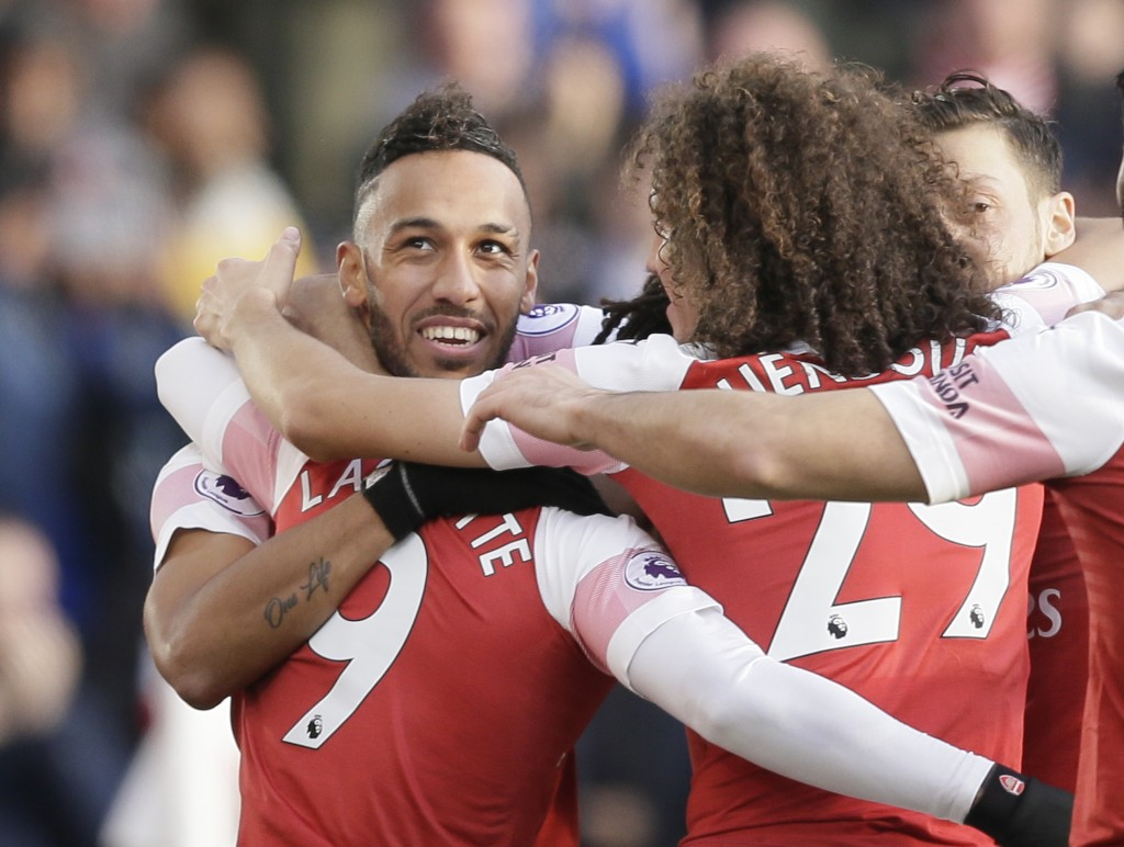 Arsenal's Pierre-Emerick Aubameyang, left, celebrate with teammates after scoring his side's second goal during the English Premier League soccer matc...