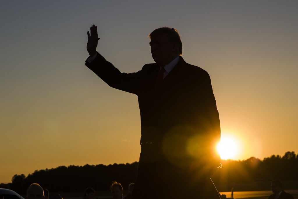 FILE - In this Nov. 26, 2018, file photo, President Donald Trump waves as he arrives to speak during a rally for Sen. Cindy Hyde-Smith, R-Miss., at Tu...