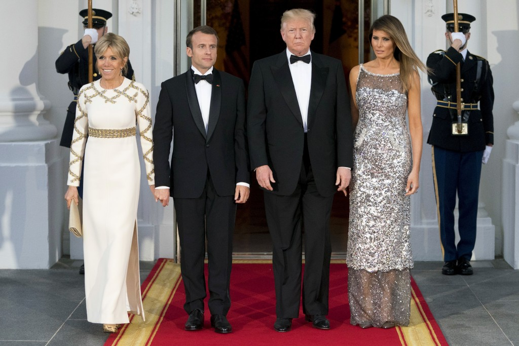 FILE - In this April 24, 2018, file photo, President Donald Trump, first lady Melania Trump, French President Emmanuel Macron and his wife Brigitte Ma...