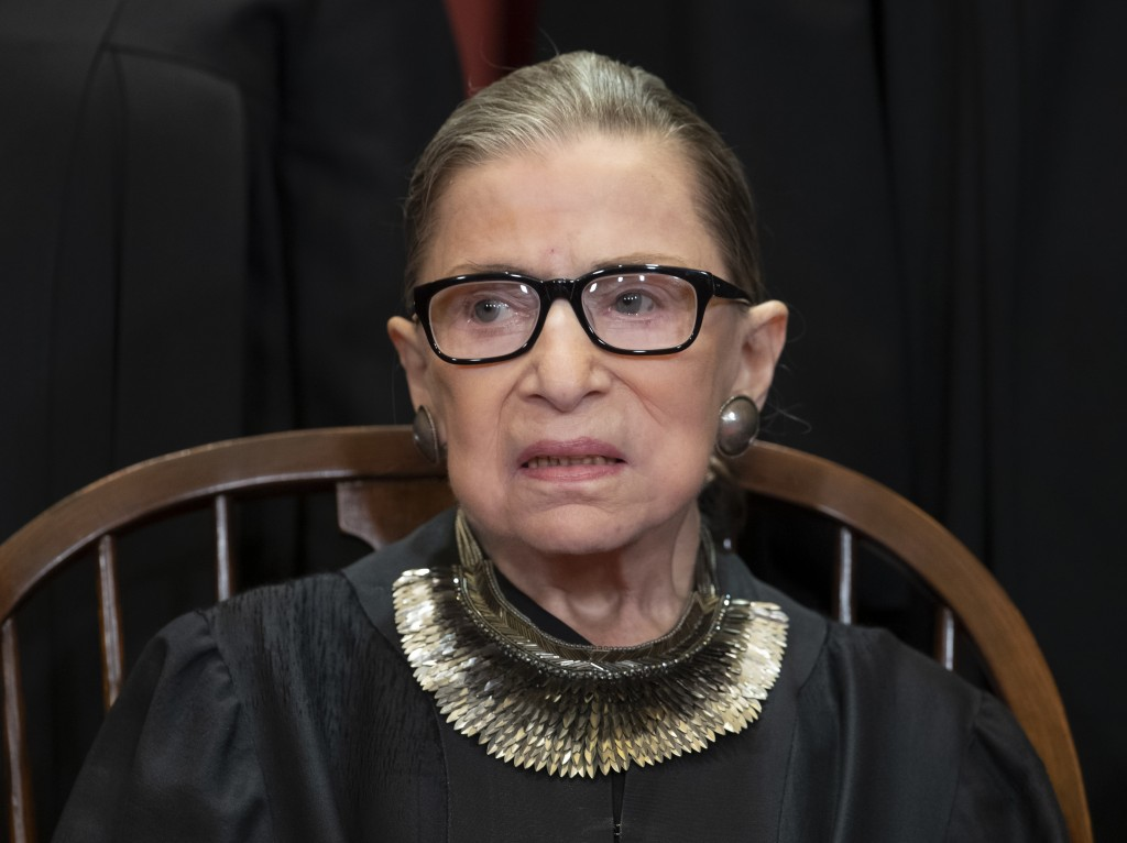 FILE - In this Nov. 30, 2018 file photo, Associate Justice Ruth Bader Ginsburg, nominated by President Bill Clinton, sits with fellow Supreme Court ju...