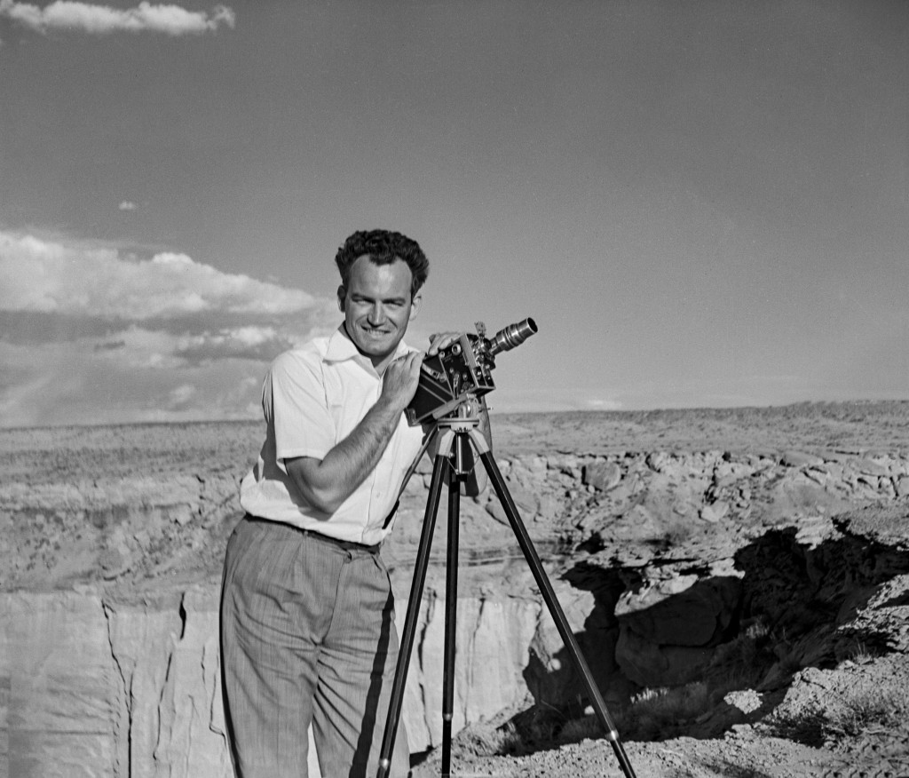 """In this photograph taken in 1935 by Peggy Goldwater, entitled """"Portrait of the Artist as a Married Man,"""" Barry Goldwater smiles and poses with his cam..."""