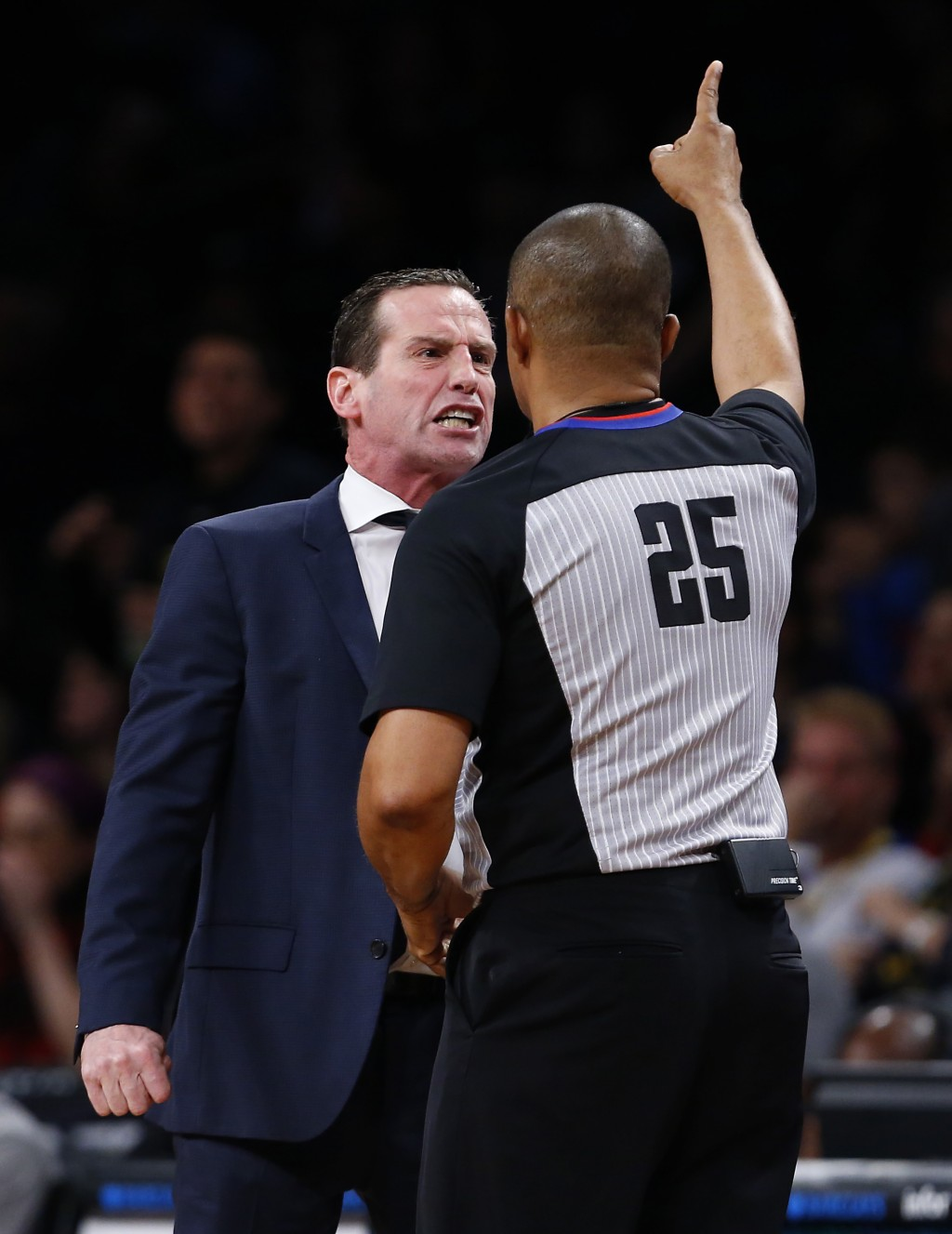Brooklyn Nets head coach Kenny Atkinson, left, argues a call with referee Tony Brothers (25) during the second half of an NBA basketball game against