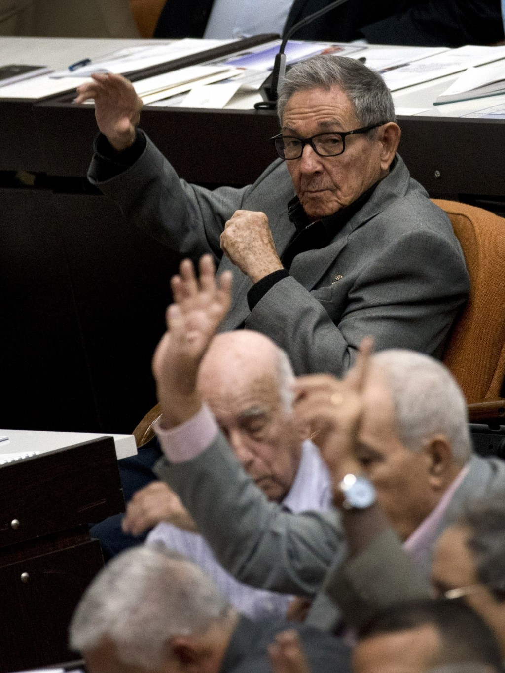 Cuba's former President Raul Castro, center, votes during a session to debate the draft of a new Constitution, at the Convention Palace in Havana, Cub