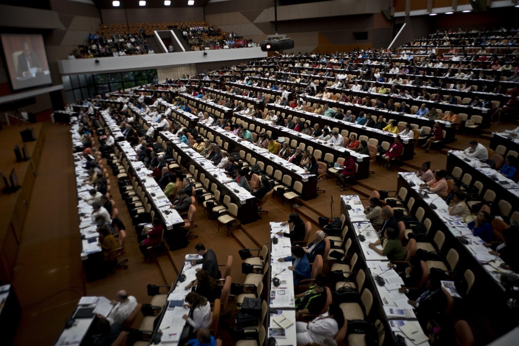 Members of the National Assembly attend a session to debate the draft of a new Constitution, at the Convention Palace in Havana, Cuba, Friday, Dec. 21...