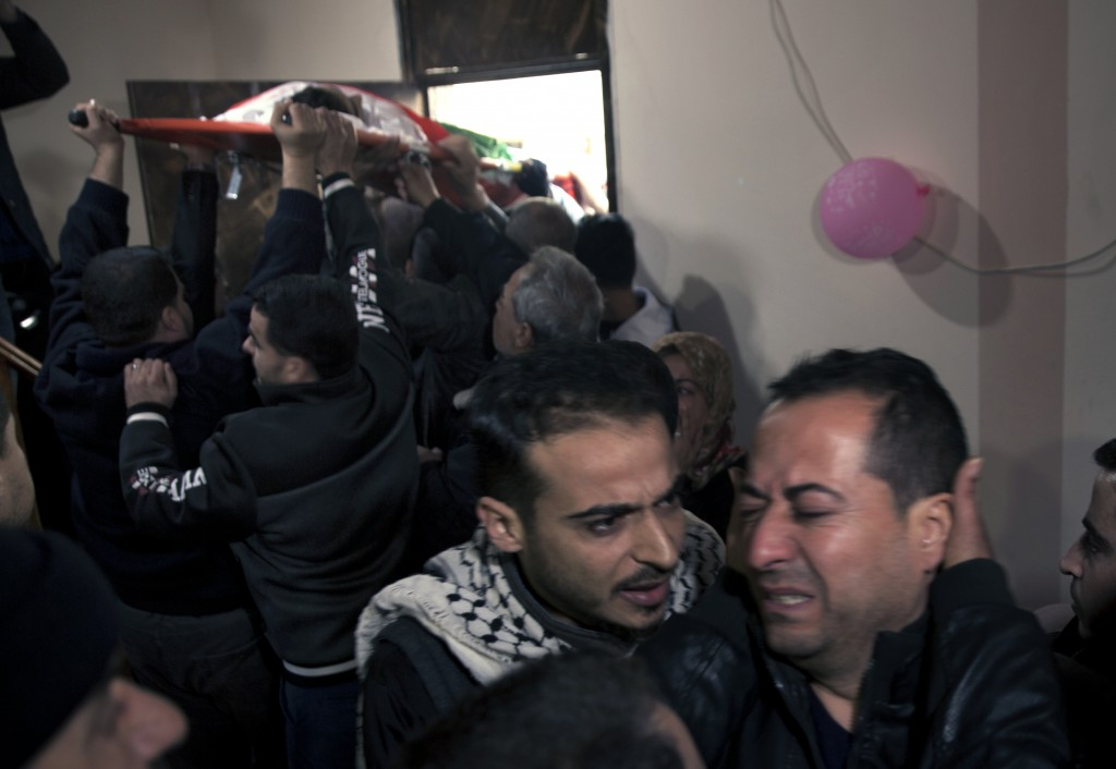 Relatives of 16 year-old Palestinian Mohammed Jahjouh, who was shot and killed by Israeli troops during a protest at the Gaza Strip's border with Isra