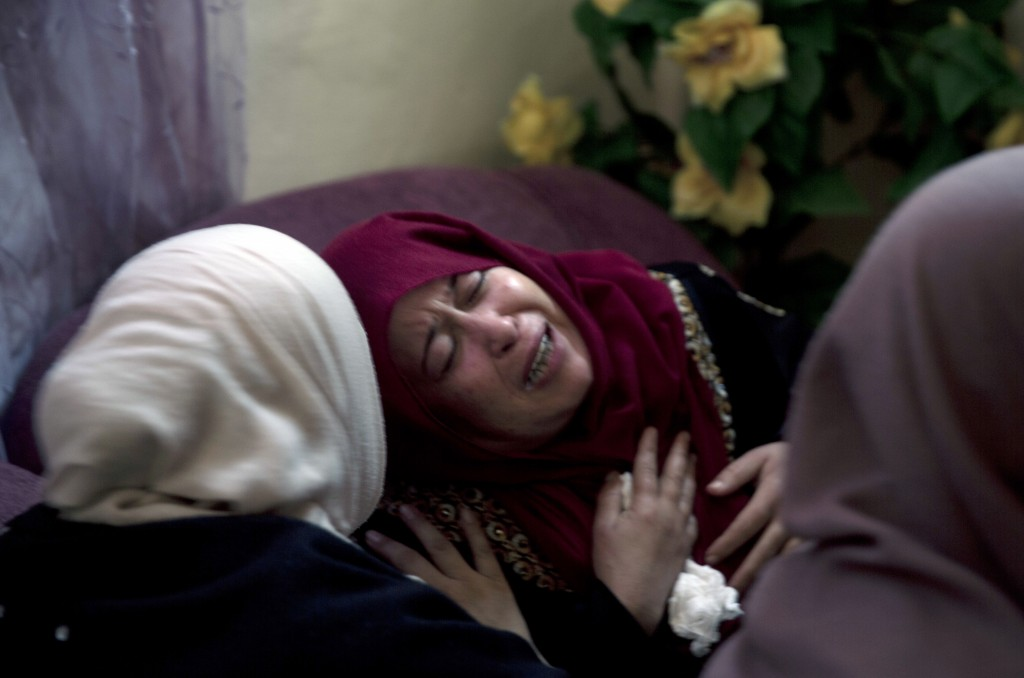Relatives of 16 year-old Palestinian Mohammed Jahjouh, who was shot and killed by Israeli troops during a protest at the Gaza Strip's border with Isra...