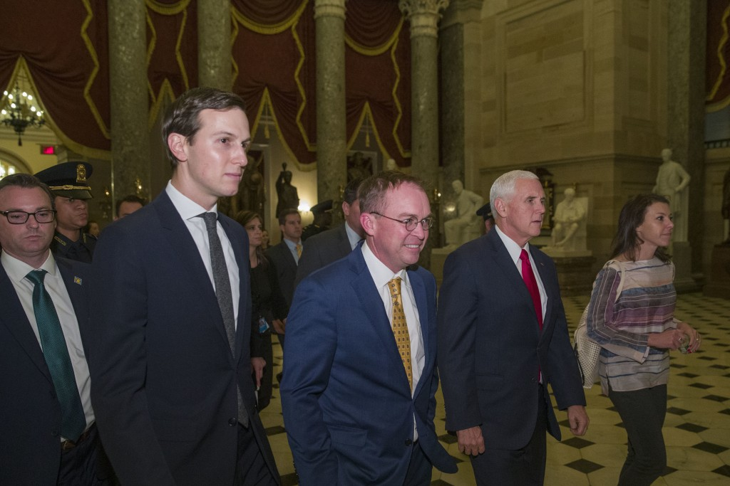 Vice President Mike Pence, second from right, walks with incoming White House Chief of Staff Mick Mulvaney, center, and White House senior adviser Jar...