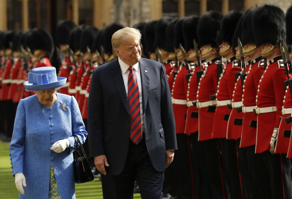 FILE - In this July 13, 2018, file photo, President Donald Trump and Britain's Queen Elizabeth II inspect a Guard of Honour, formed of the Coldstream ...