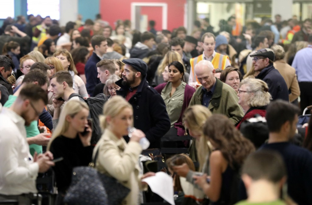 Passengers at Gatwick airport waiting for their flights following the delays and cancellations brought on by drone sightings near the airfield, in Lon...