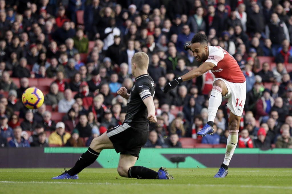 Arsenal's Pierre-Emerick Aubameyang, right, scores his side's second goal during the English Premier League soccer match between Arsenal and Burnley a...