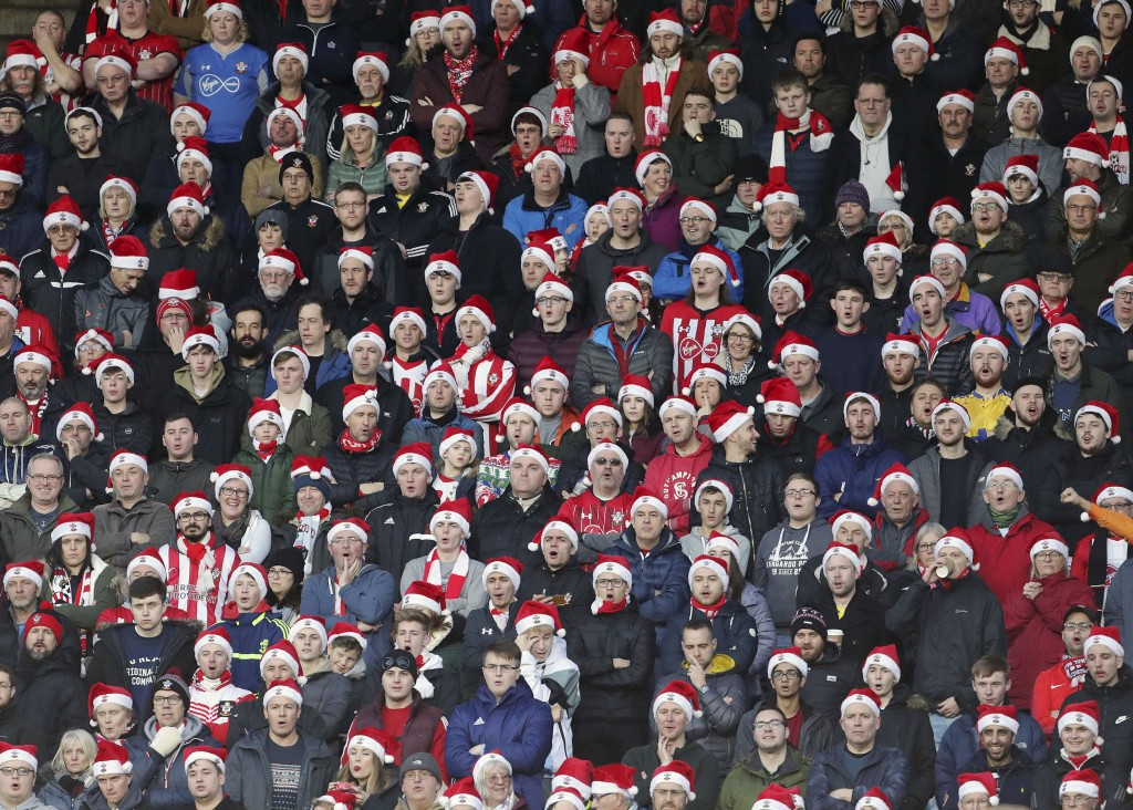 Southampton fans in Santa Hats during the English Premier League soccer match between Huddersfield Town and Southampton at the John Smith's stadium, H